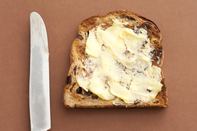 slice of bread with spreading butter