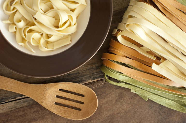 cooked fettuccini on plate  from above