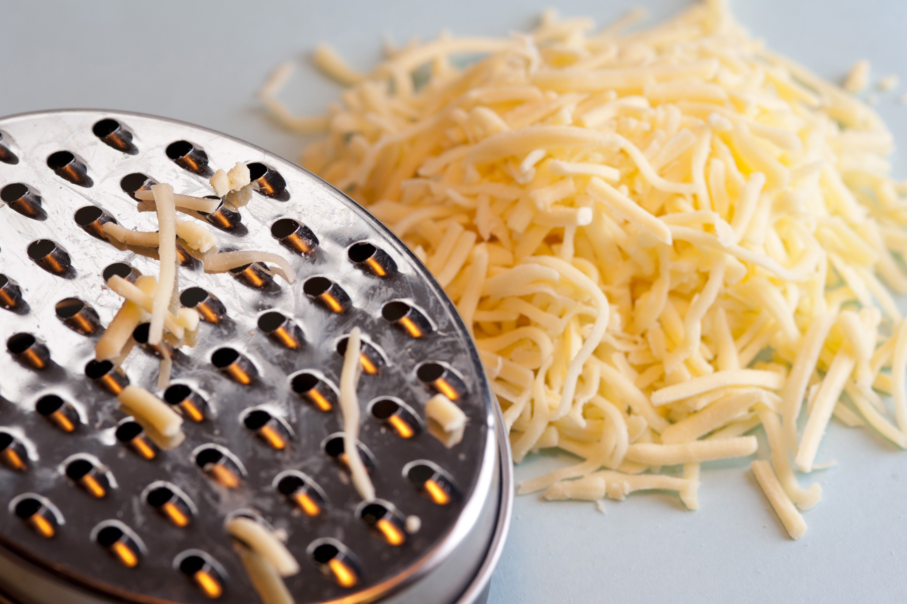 Grating hard cheese - Free Stock Image