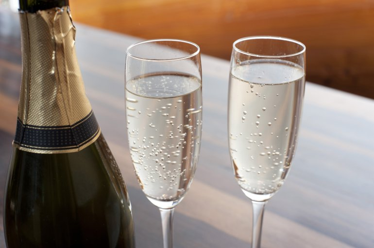 two elegant flutes of sparkling champagne