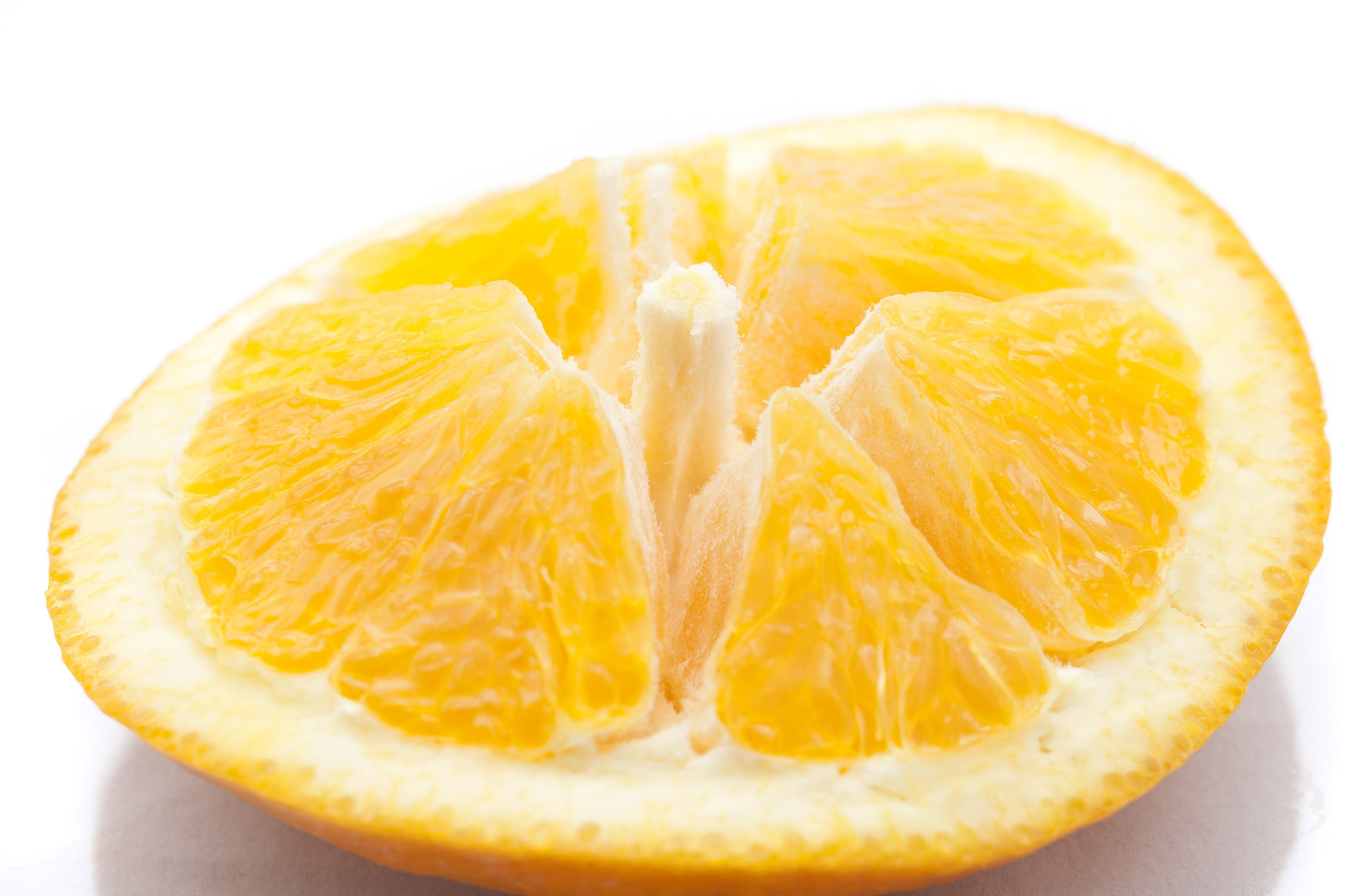 Sliced orange showing the structure of the fleshy pulp and segments on the rind