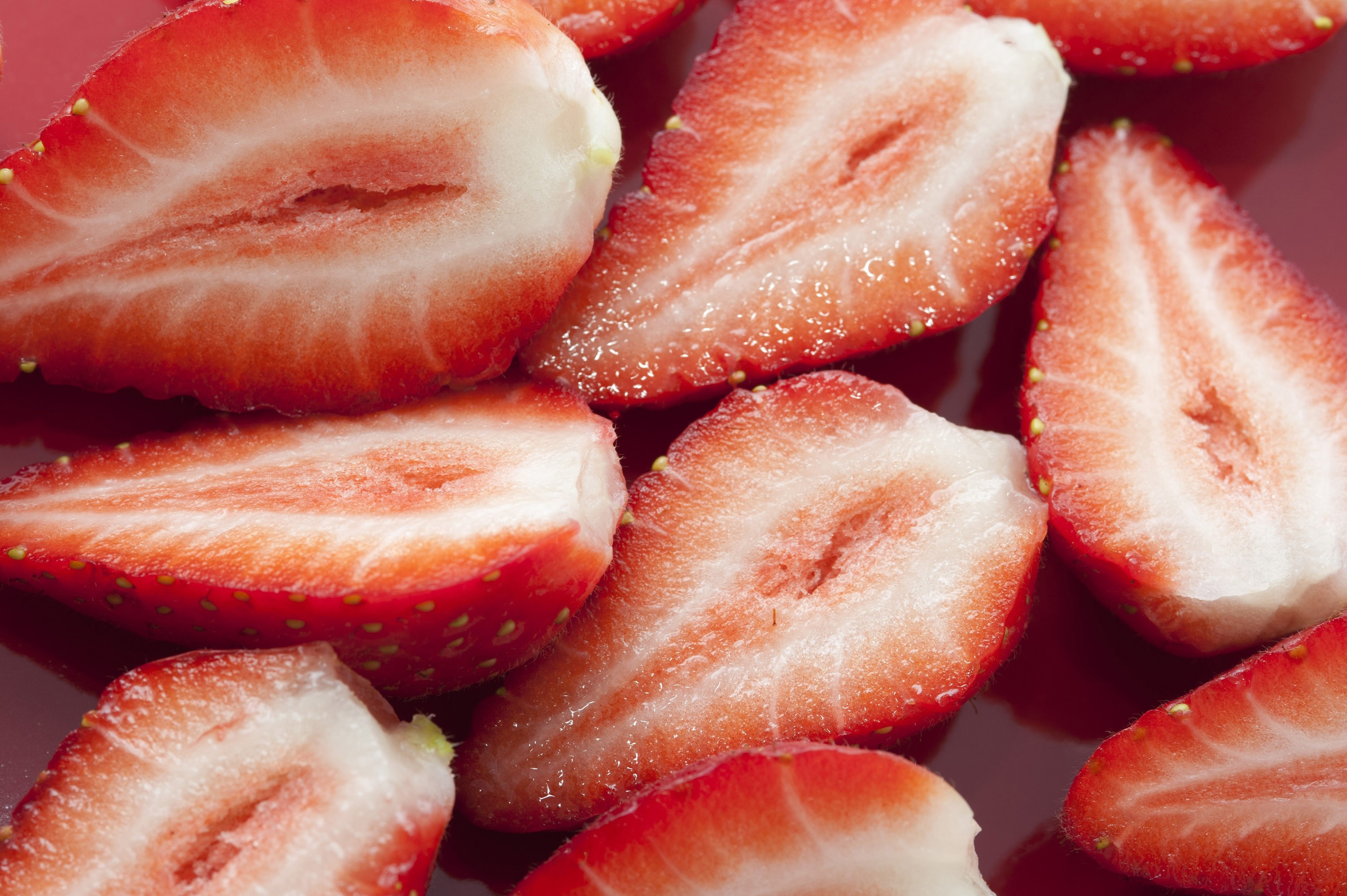 Close-up of fresh tasty strawberries cut in halves
