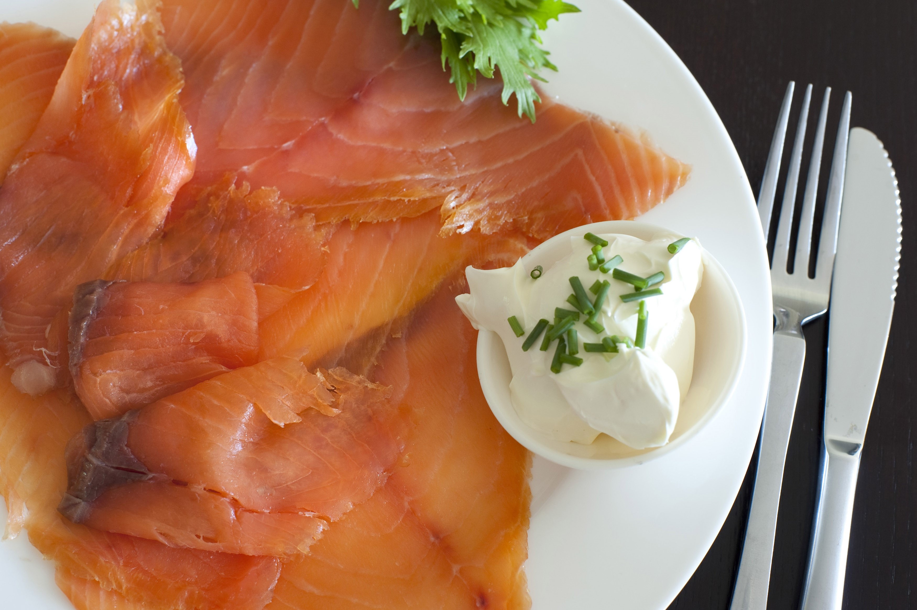 Gravlax, or thinly sliced cured smoked salmon with cream cheese and chives served as an appetizer