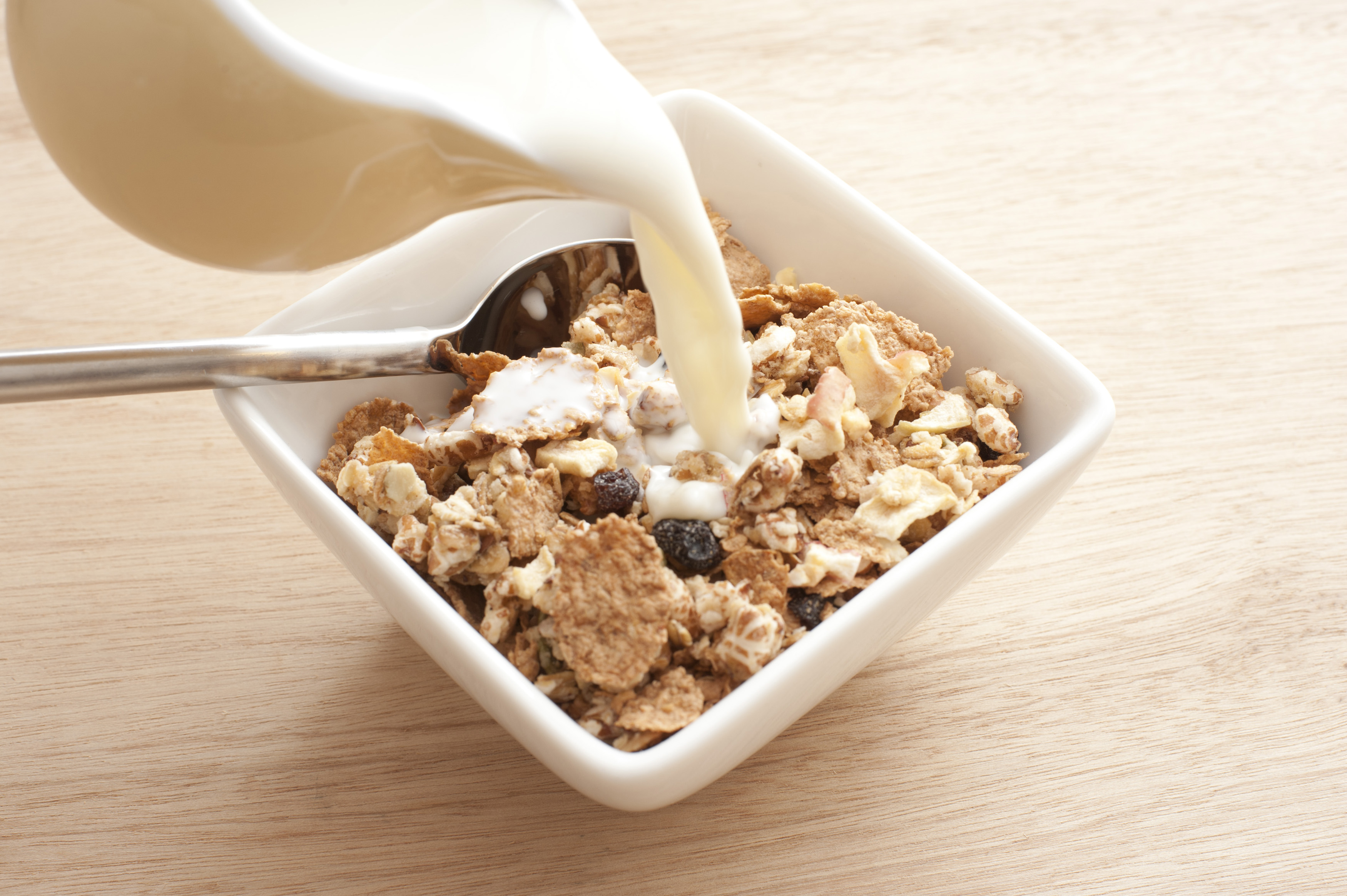 Pouring milk into cereal - Free Stock Image